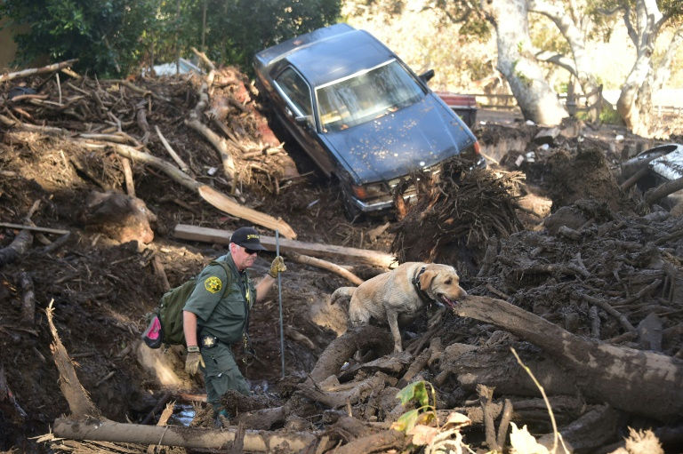 Mangled car, destroyed homes show mudslide devastation