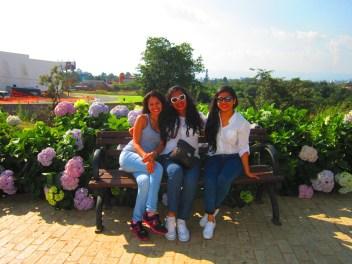 girls-sitting-paseo-cayala-bench