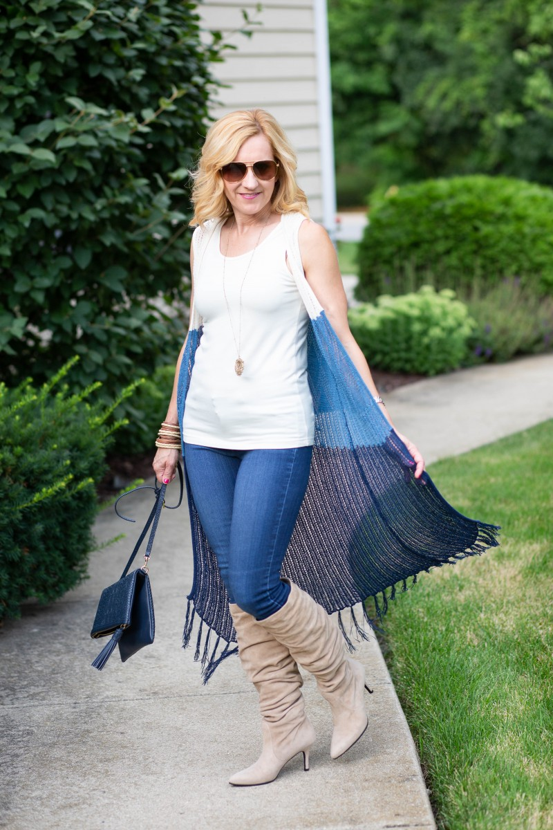 Boho chic look with Stuart Weitzman suede boots and a fringed long vest.