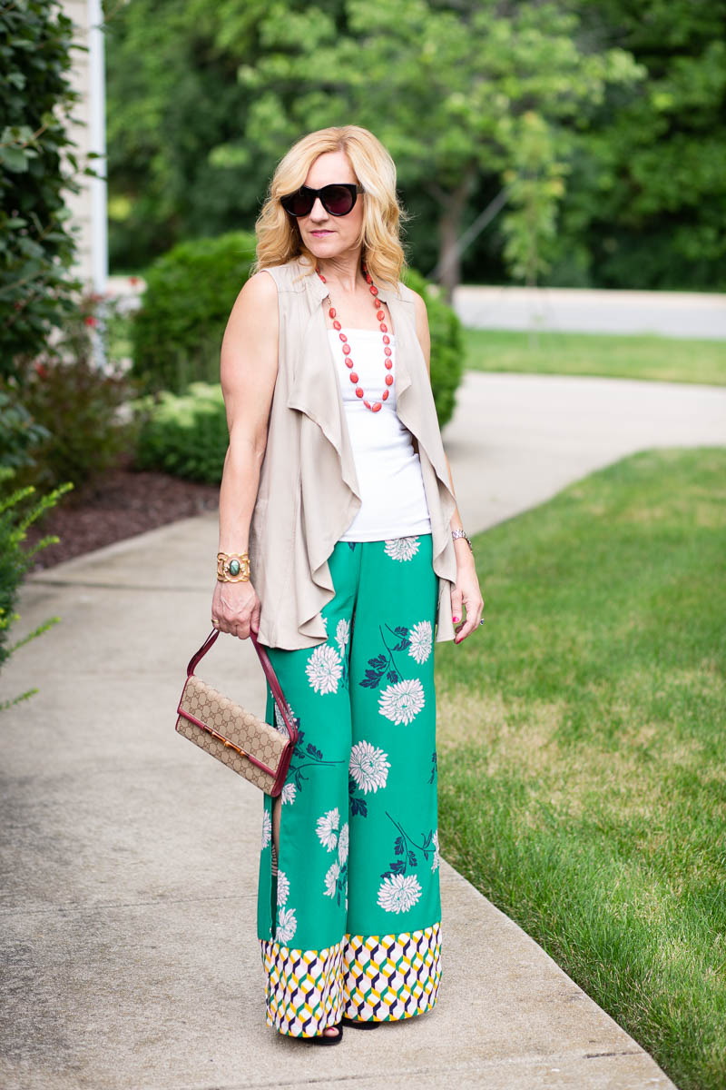 Light Tan Vest paired with Floral Palazzo Pants.