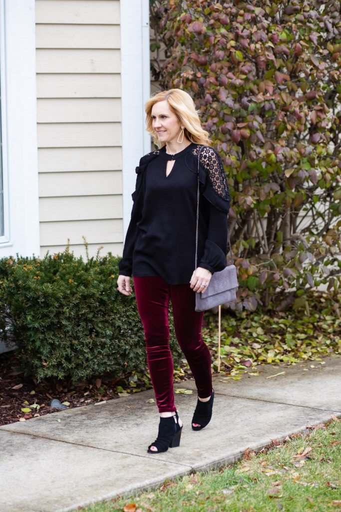 Girl's night out look featuring a black crochet top with velvet leggings.