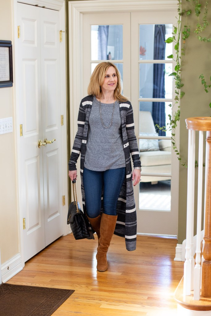 Casual chic look featuring a long striped cardigan, grey tee and tan suede knee boots.
