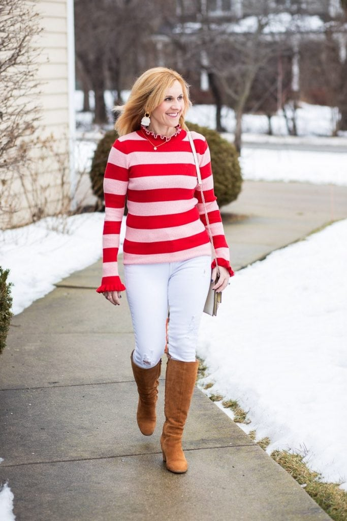 Casual Valentine's Day look featuring a pink and red striped top with white jeans.