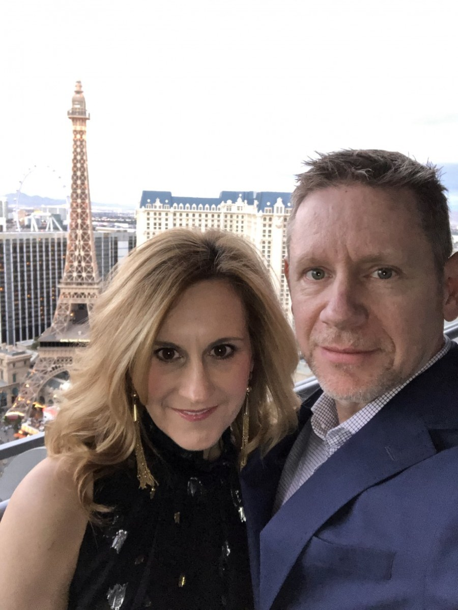 My husband and I on the balcony of our hotel room at the Cosmopolitan with the Paris' Eiffel Tower in the background.