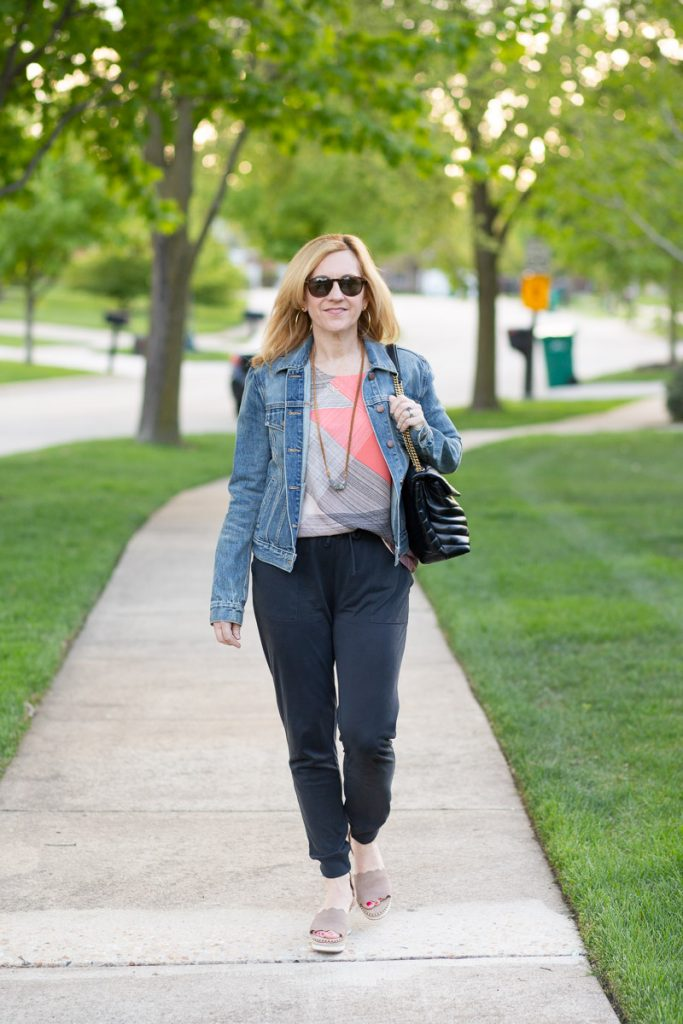 Casual spring look featuring joggers, printed tank, denim jacket, and espadrille wedges.