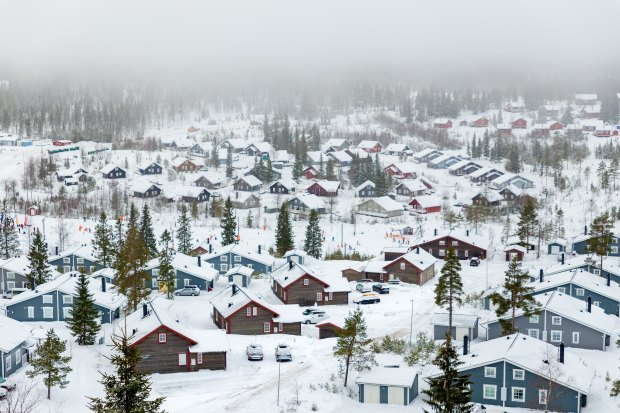 Wintry image of a mountain village covered in snow