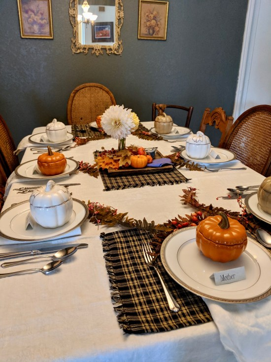 Festive fall table setting with pumpkin soup bowls