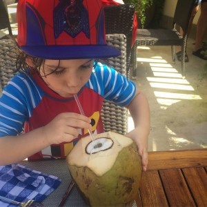 my son enjoying a coconut