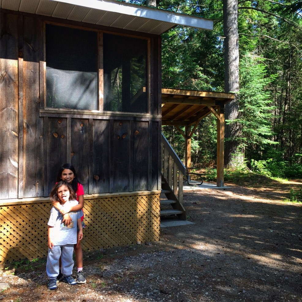 my kids outside the cabin at Bonnechere