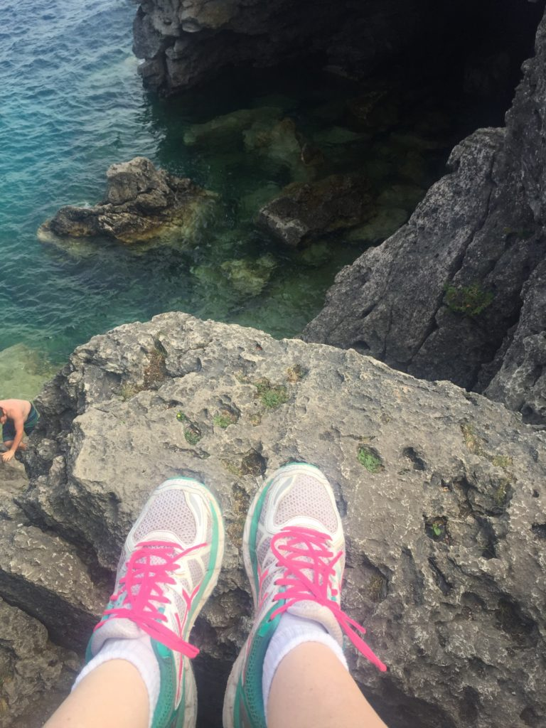 feet over ledge at grotto