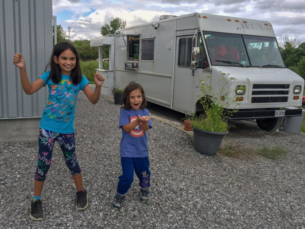 Luxury Family Glamping Ontario, kids dancing outside food truck