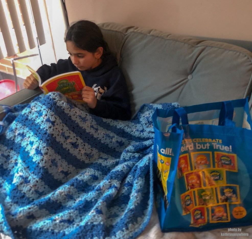 Child reading Weird But True Christmas