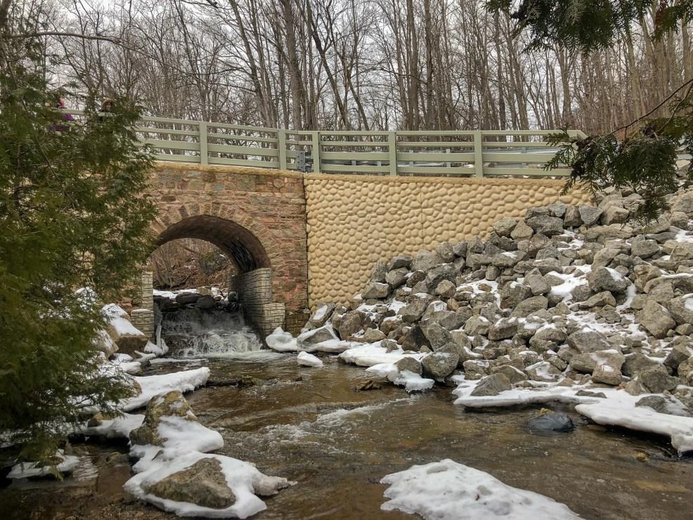Old Bridge and Frozen Waterfall on hike in Silvercreek Conservation Area #silvercreekconservationarea #brucetrail #womenwhoexplore #womenwhoexploreontario #discoveron #ontarioforyou #girloutdoor #girlsthatwander #hikingculture #gogalavanting #girlswhohike #explorecanada