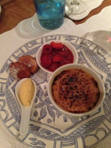 Creme Brulee, with vanilla ice cream, berry compote & madeleines.