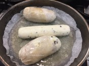 Chicken Ballotine & Boudin cooking on the stove top.