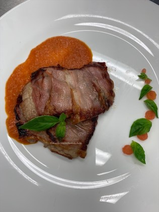 Pan fried Veal Loin medallions with sage wrapped in Prosciutto with Tomato Sauce