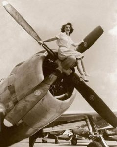 Woman with vintage plane