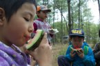 Everyone enjoys an afternoon snack of watermelon before driving back down the mountain.