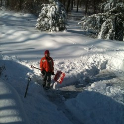 boy earning money old school: shoveling snow
