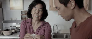 David Au's Eat With Me Film starring Sharon Omi. Woman folds dumplings.