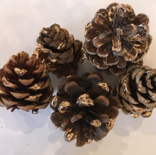 Copper foiled pine cones