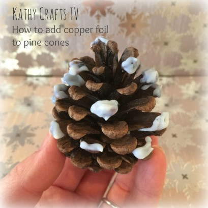 Coat the ends of the pine cone with foil applicator glue