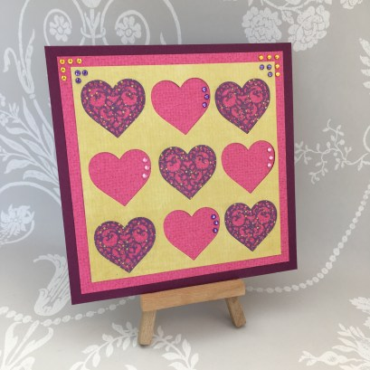 Card made using the Dovecraft layered hearts die
