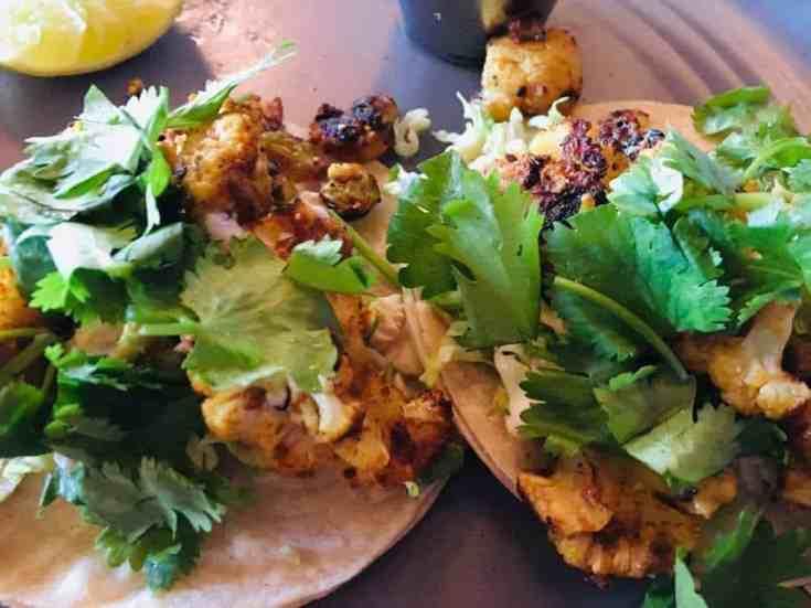 Skinny Roasted Cauliflower Tacos with Avocado Cilantro Cream