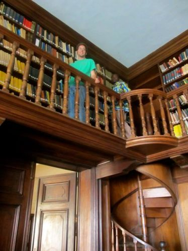 Spiral staircase leads to the upper balcony of books