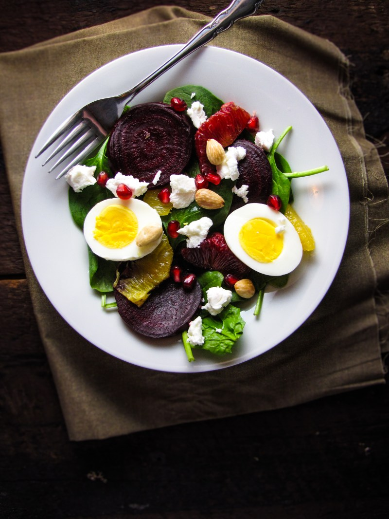 Roasted Beet and Spinach Salad with Eggs, Goat Cheese, Pomegranate, and Orange {Katie at the Kitchen Door}