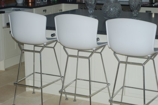 Photograph of three white Knoll Bertoia Moulded Shell Barstools with chrome legs, taken by Katie at katiecould.com