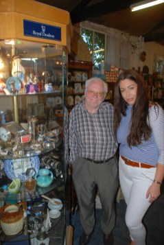 Katie and Katie and David Miller at Upstairs Downstairs Antiques Gloucester in front of his cabinet