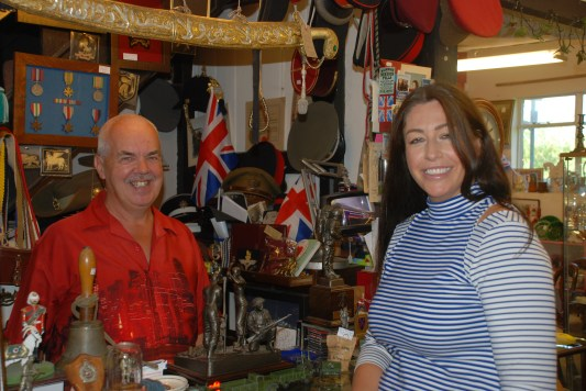 Katie and Rob Ridler looking at the Military Section at 'Upstairs Downstairs' Antiques