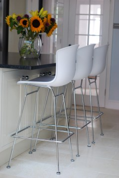 Photograph taken by Katie at katiecould.com of the white Knoll Bertoia Moulded Shell Barstools with chrome legs
