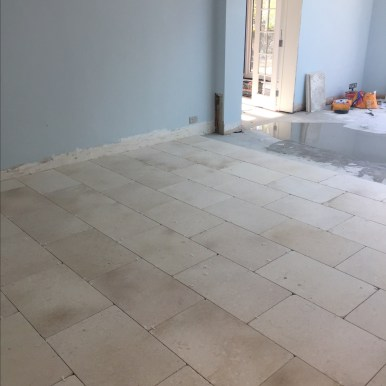 Katie's Limestone tiles going down
