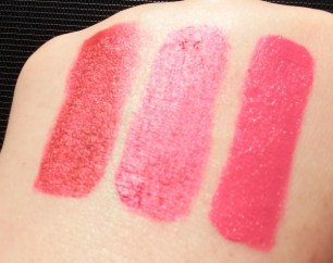 The Body Shop Metal Lip Liquid in Plum Titanium and Fuchsia Chrome and Matte Lip Liquid in Tokyo Lotus hand swatches in direct sunlight to see the metallic shine