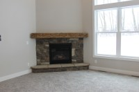 Fireplace Designs and the Rustic Mantel Trend!  Katie