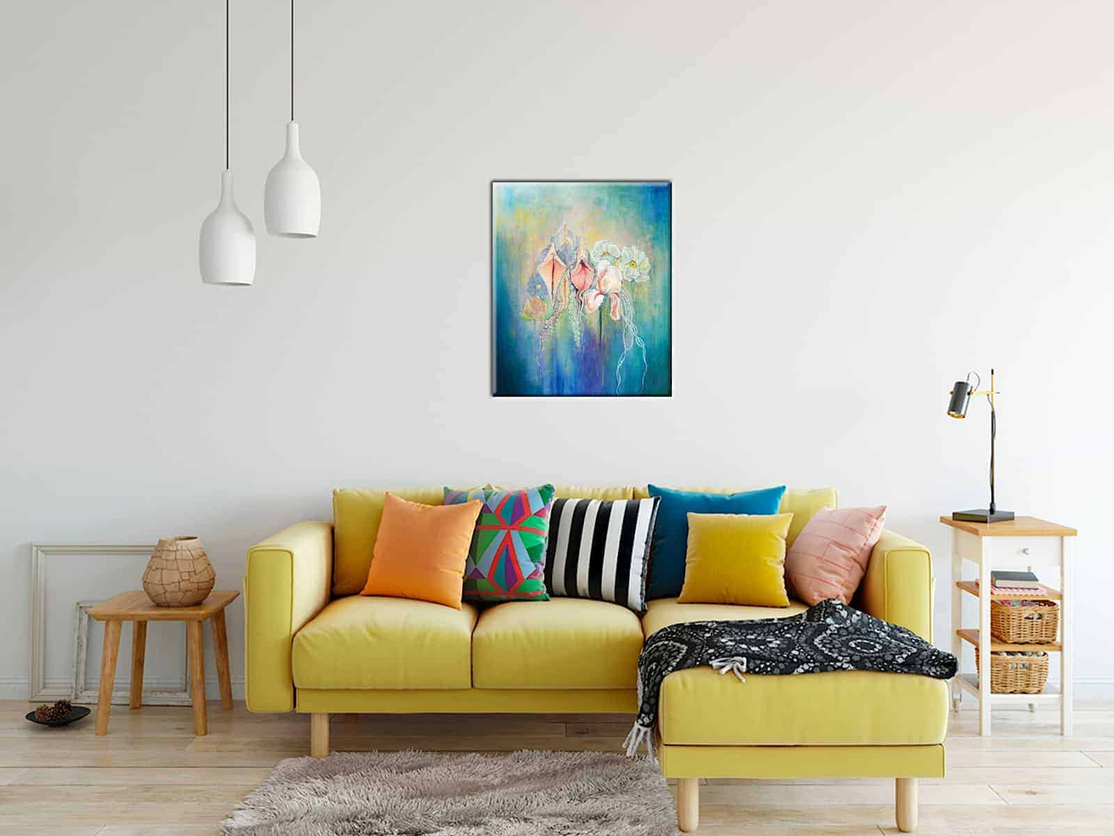 Mock up picture of yoni's in bloom on a wall above a yellow sofa