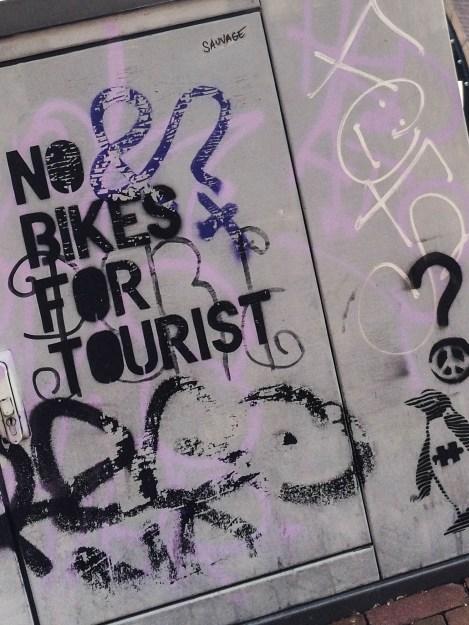 no bikes for tourist graffiti near the Magere bridge and the Hermitage Museum in Amsterdam