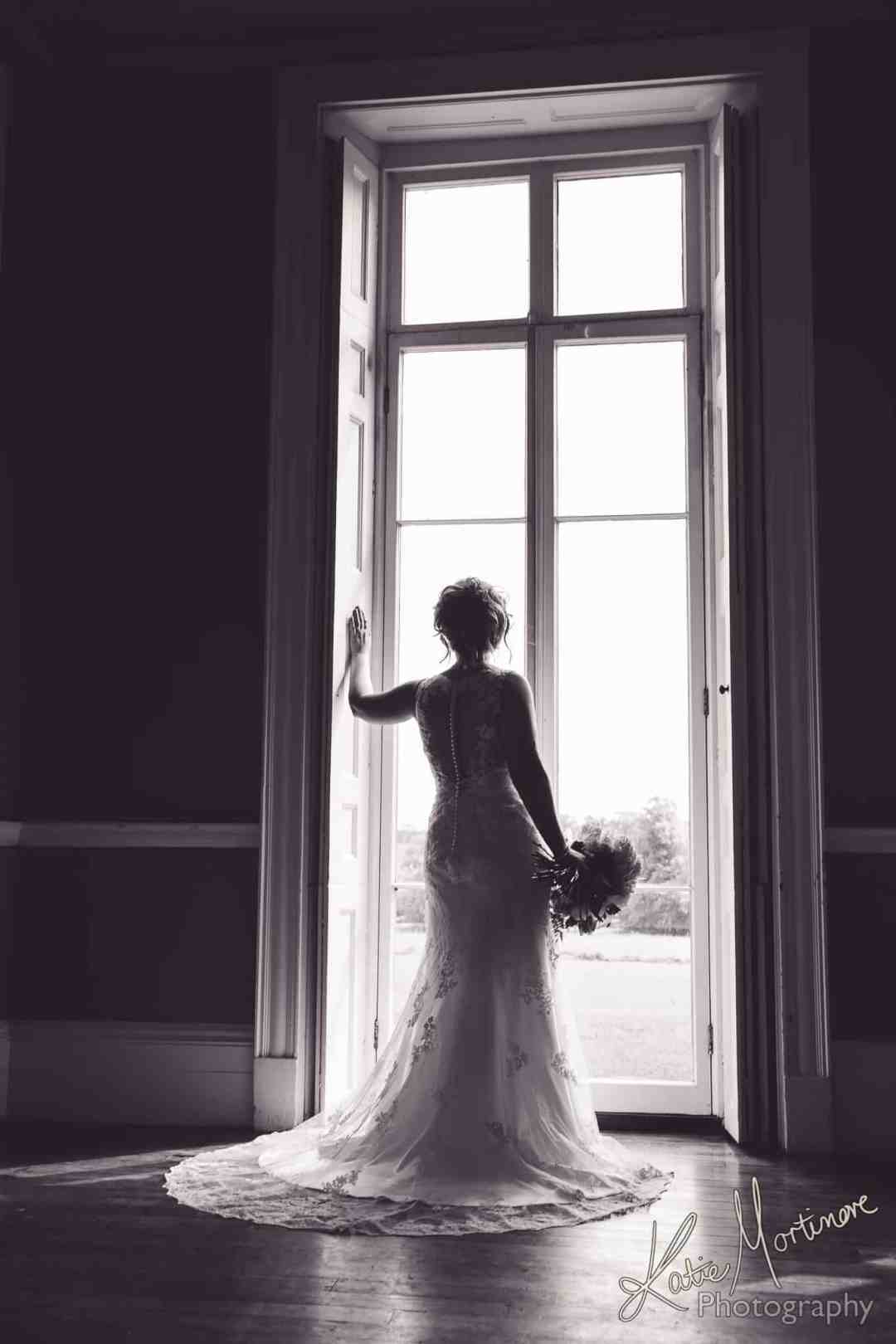 Penton Park Hampshire Wedding Photography beautiful bride tall window