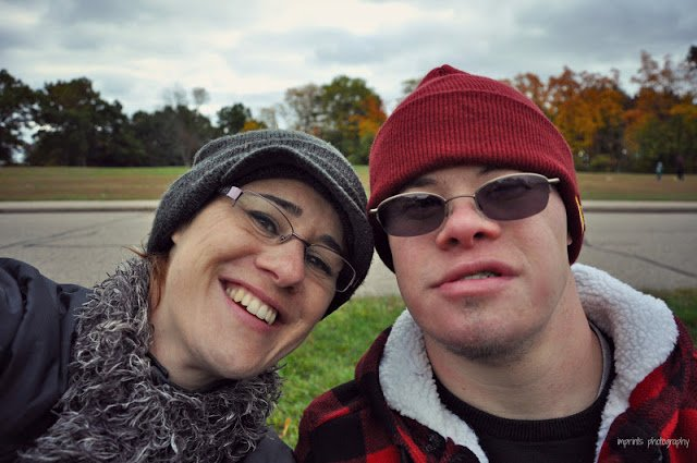 Sibling with her brother with Down Syndrome with hats on