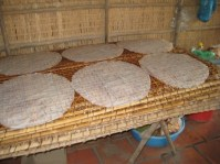 Rice paper drying: the woven mats are the explanation for the patterns on the paper.
