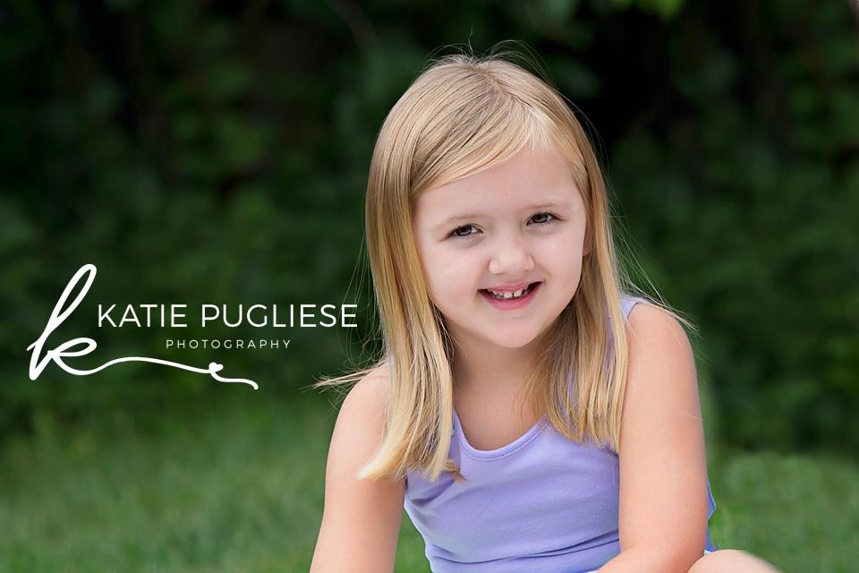 Toddler girl smiling at camera