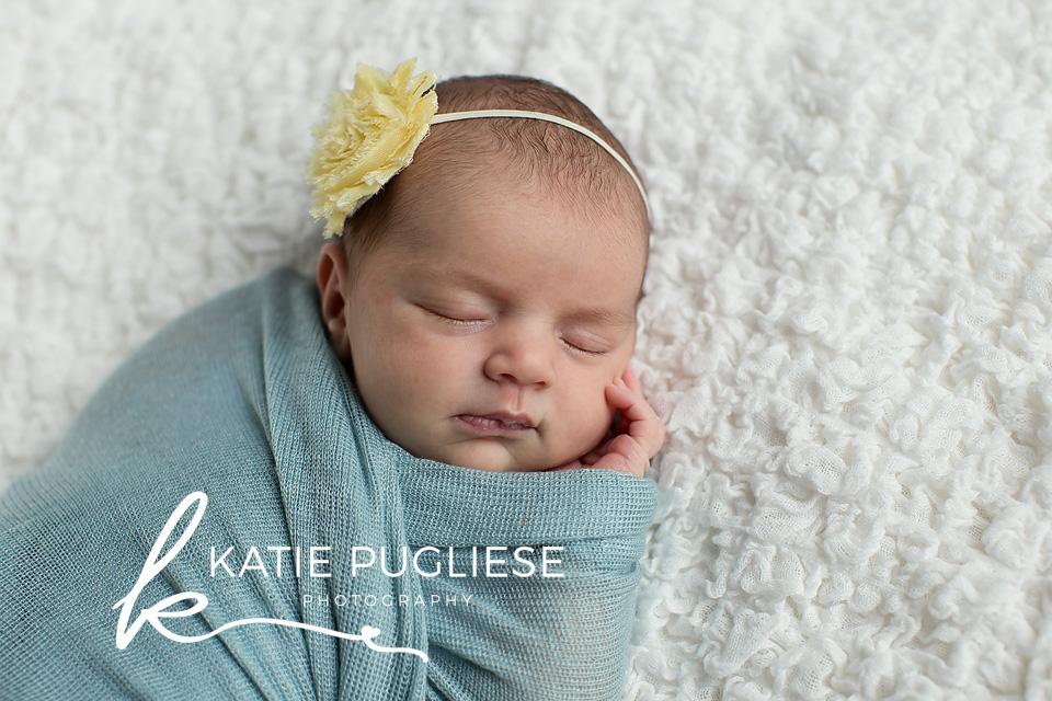 Newborn baby girl sleeping on blanket