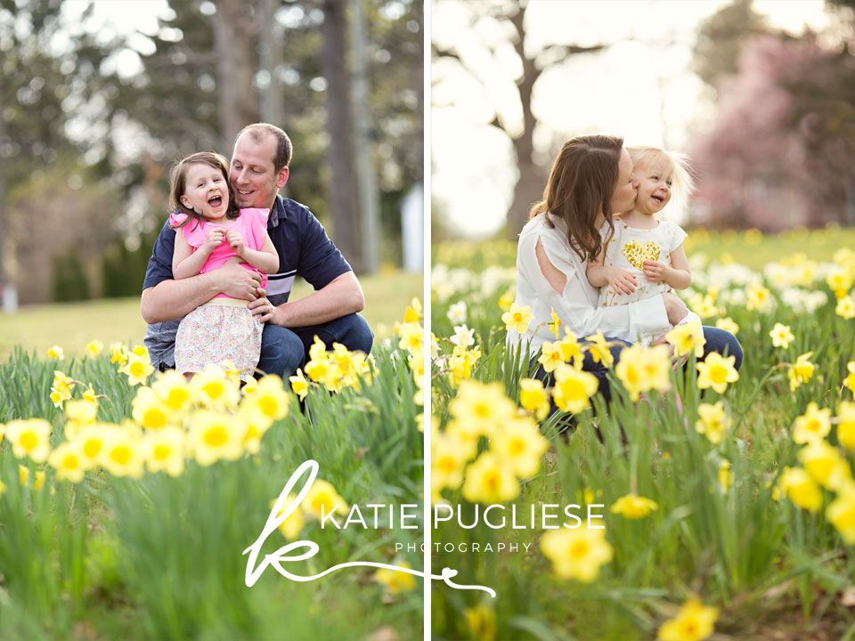 Mom and Dad with daughters having fun in flower field