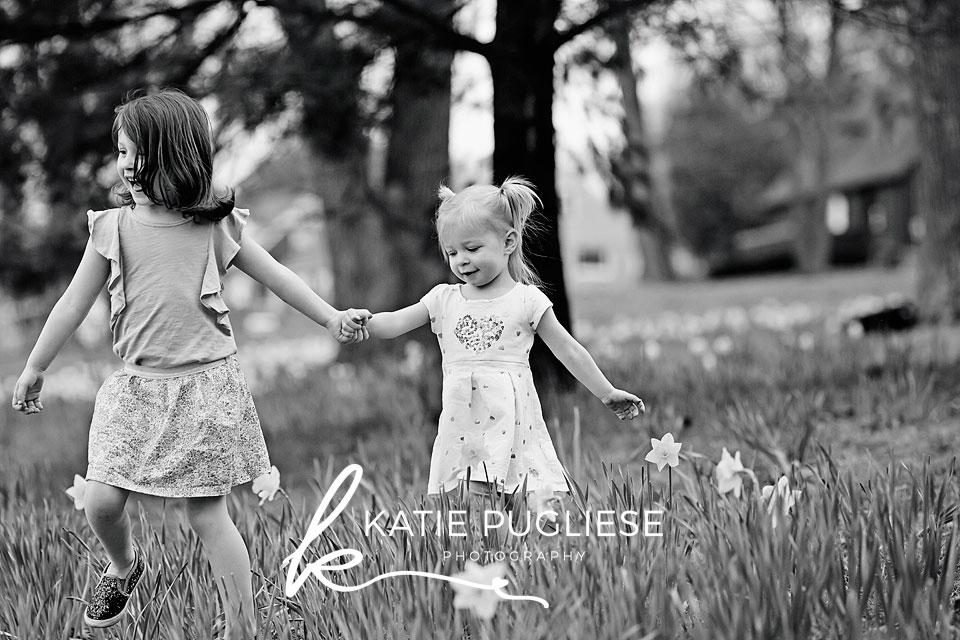 Sisters walking in flower field