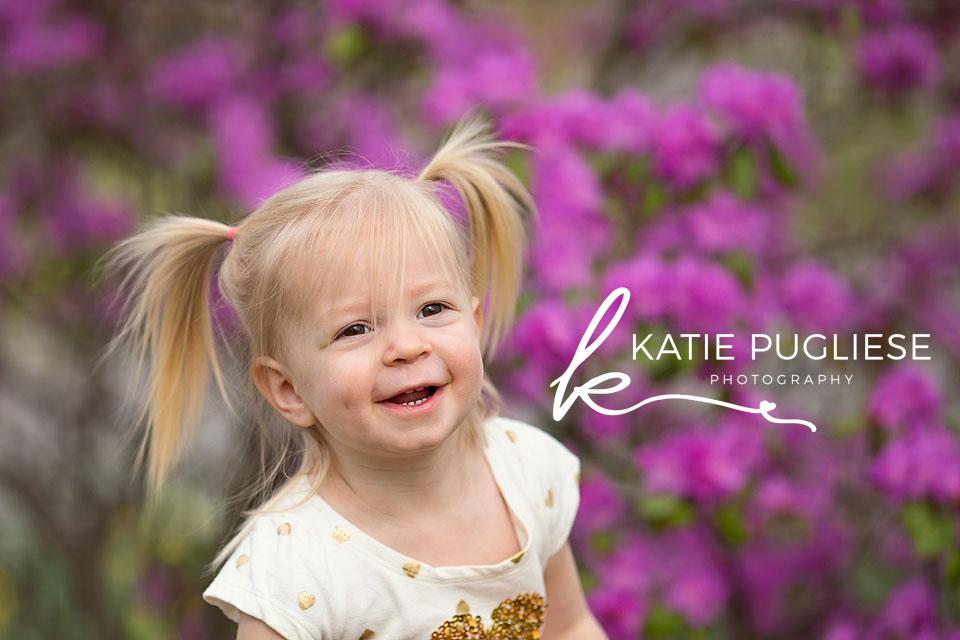 Toddler girl in flower field