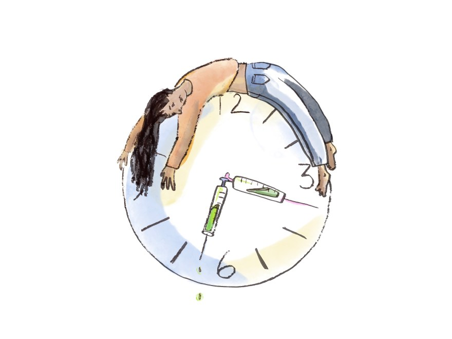 A woman is slumped over an oversized clock. The clock's hands are syringes