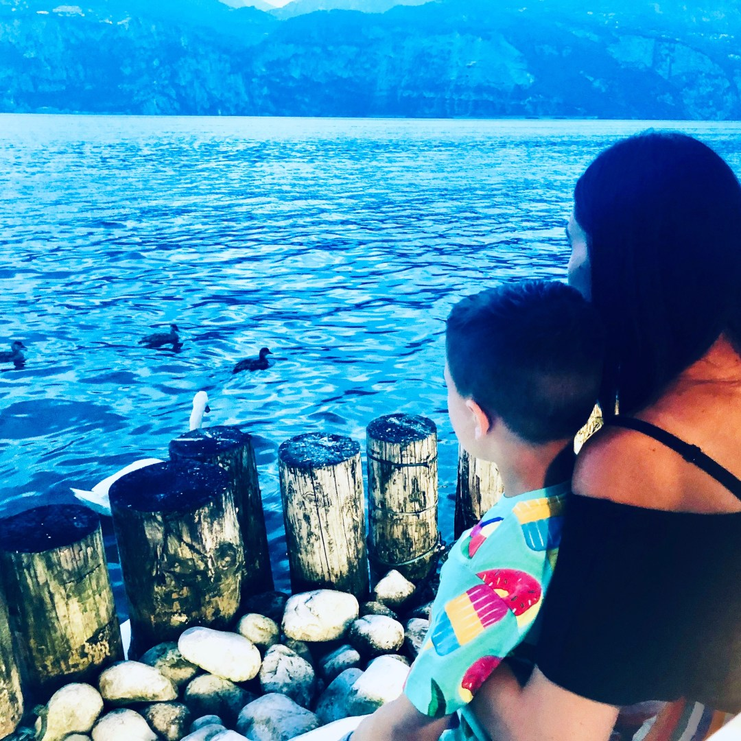 Me and Harvey looking out on the lake at lake garda,