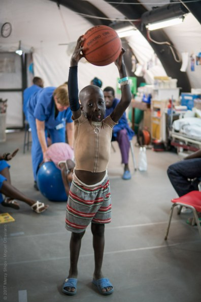 Saidou gets a workout with a basketball in the rehab tent.